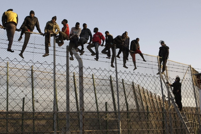 Illegals-jumping-a-border-fence